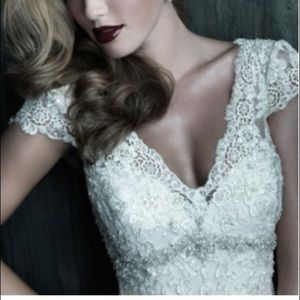 Never worn!Allure Ivory lace wedding gown.